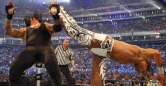 Shawn Michaels delivers a dose of Sweet Chin Music to The Deadman | Credit: WWE